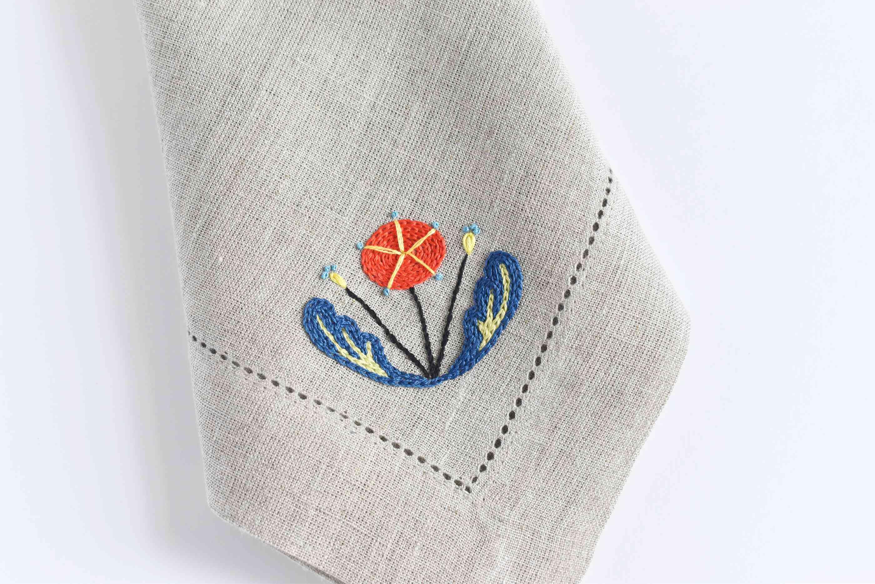 Scandinavian flower embroidered onto a napkin