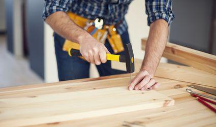 Close up of man hitting nail by hammer