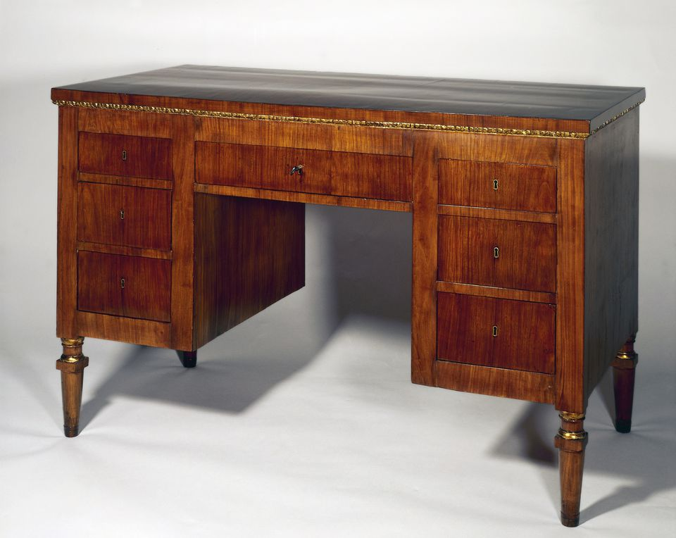 A Directoire style cherry wood Venetian writing desk.