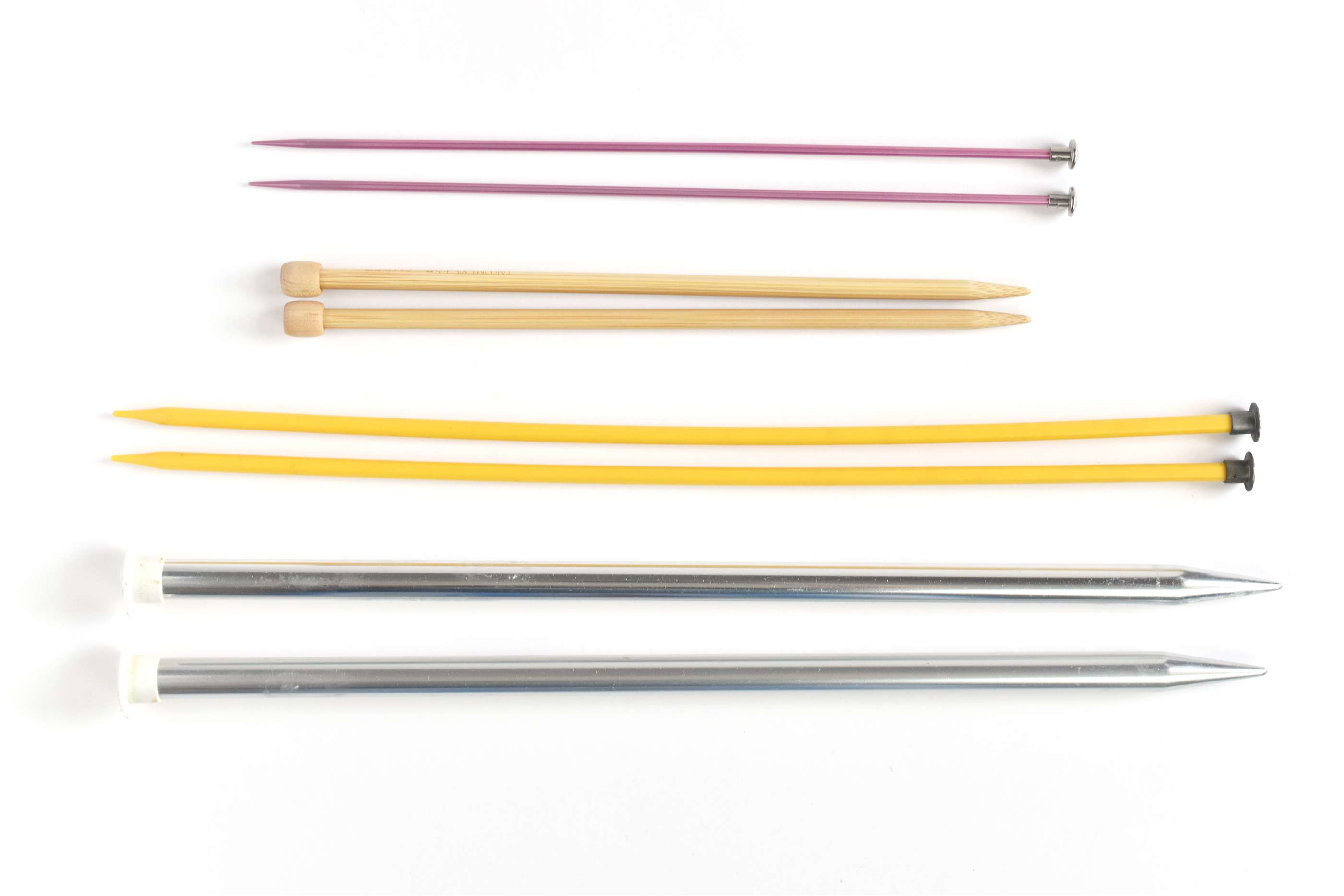 Four Sets of Straight Knitting Needles in Different Sizes and Materials