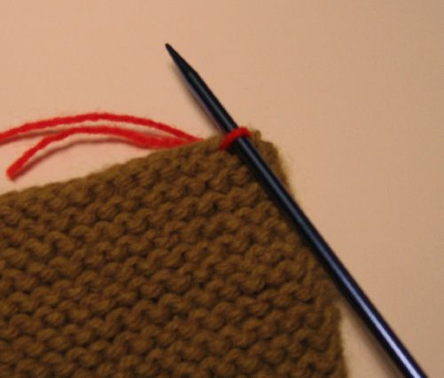 A stitch picked up and knitted.