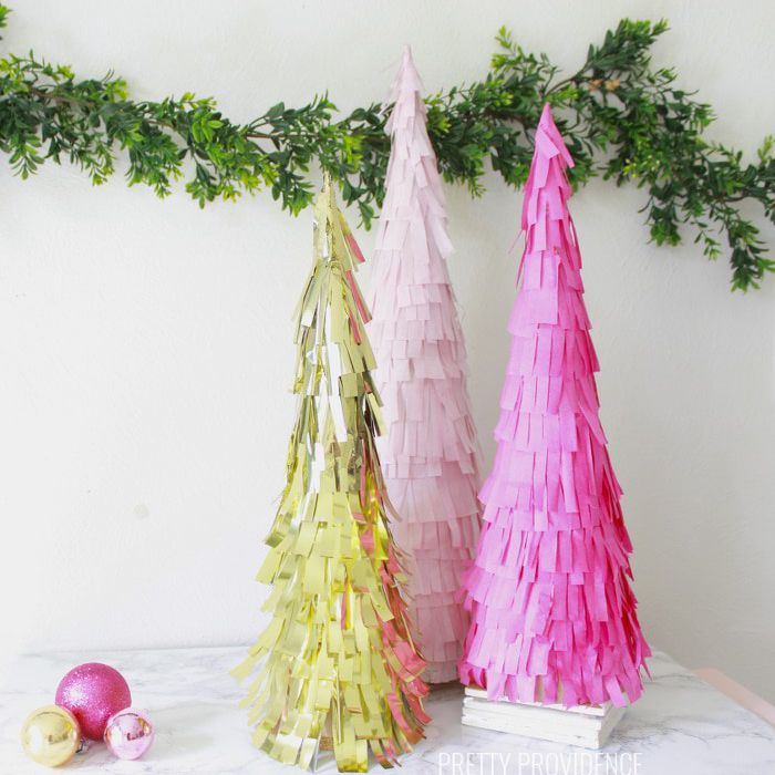 gold and pink Christmas trees made from fringed paper.