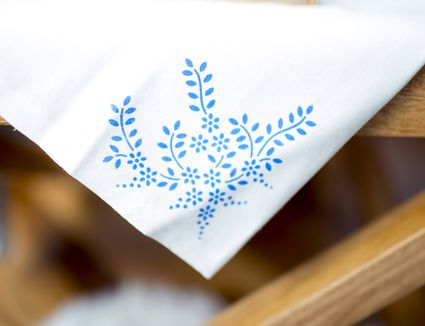 blue stencil on white fabric