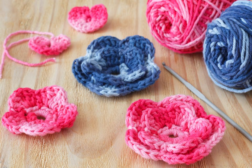 Handmade pink and blue crochet flowers and heart