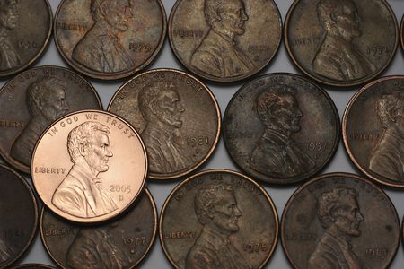 Three Lines Of Old Pennies And One Shiny New One