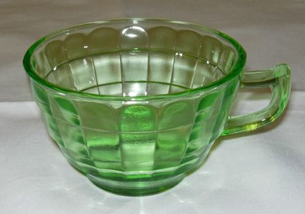 Green depression glass cup