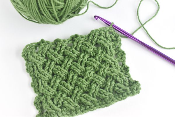 Celtic Weave Stitch Swatch With Green Yarn Ball and Crochet Hook