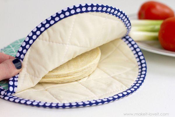 A fabric tortilla warmer with tortillas inside