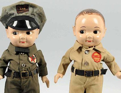 A pair of Buddy Lee dolls