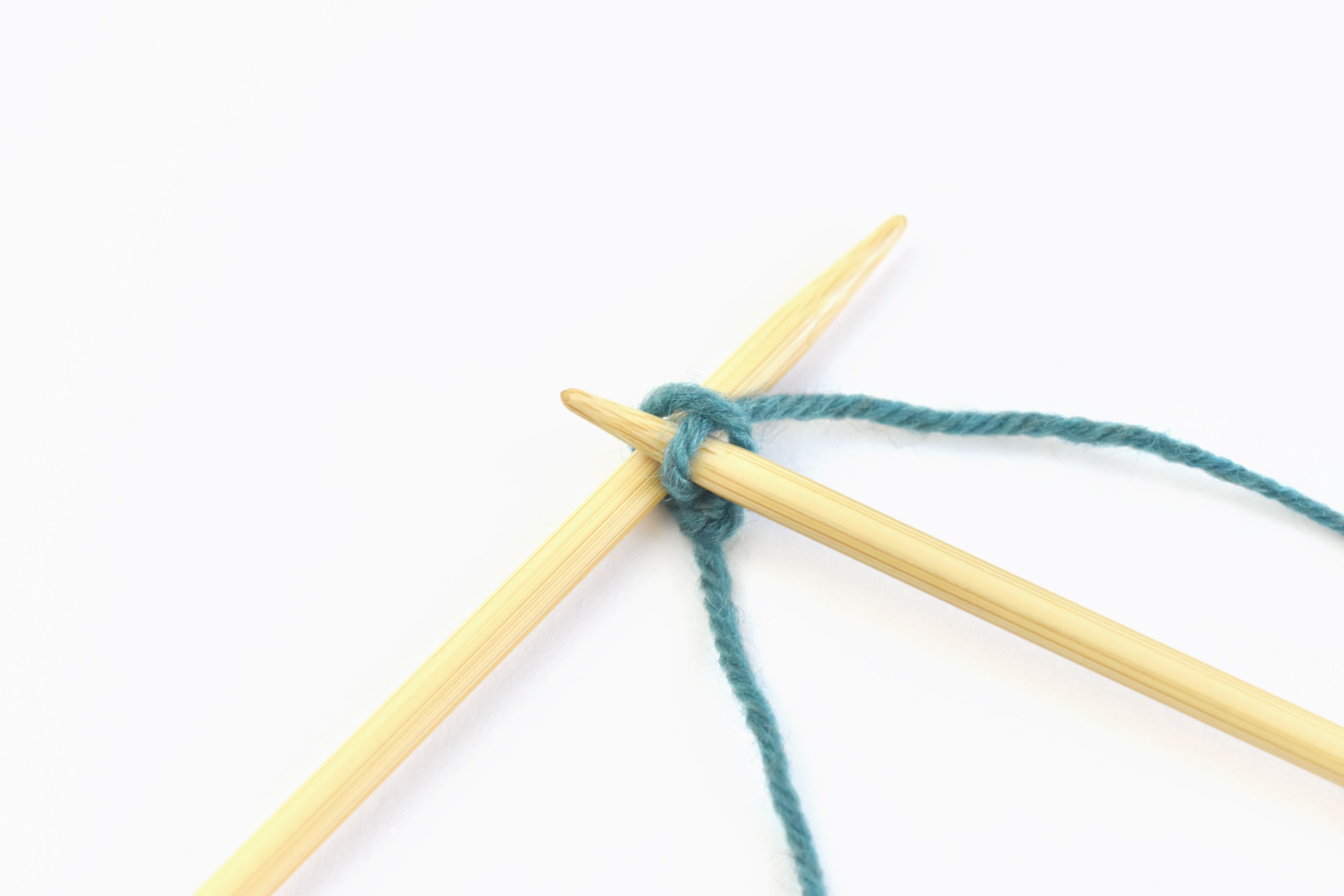 Bring the Yarn Through the First Stitch