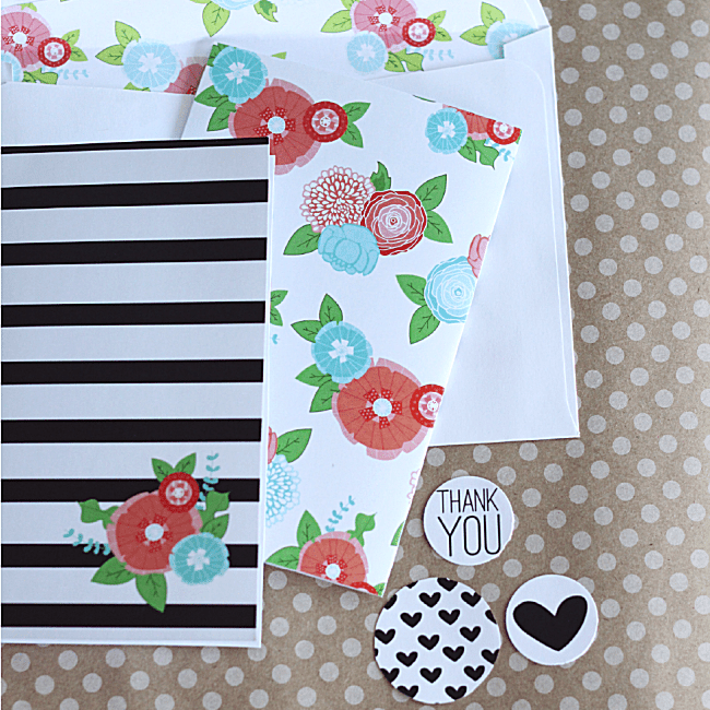 A floral and striped stationery set laying on a table.