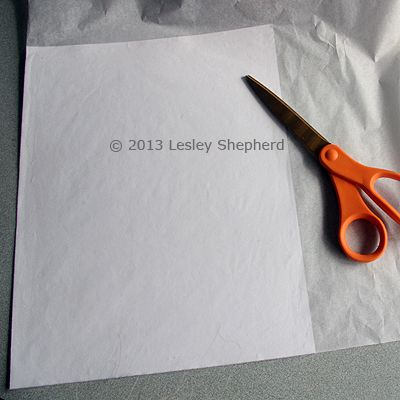 Tissue glued to printer paper backing