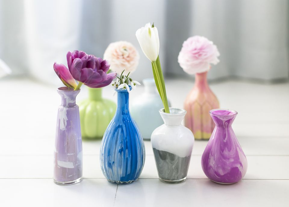 Flowers in marbled glass vases
