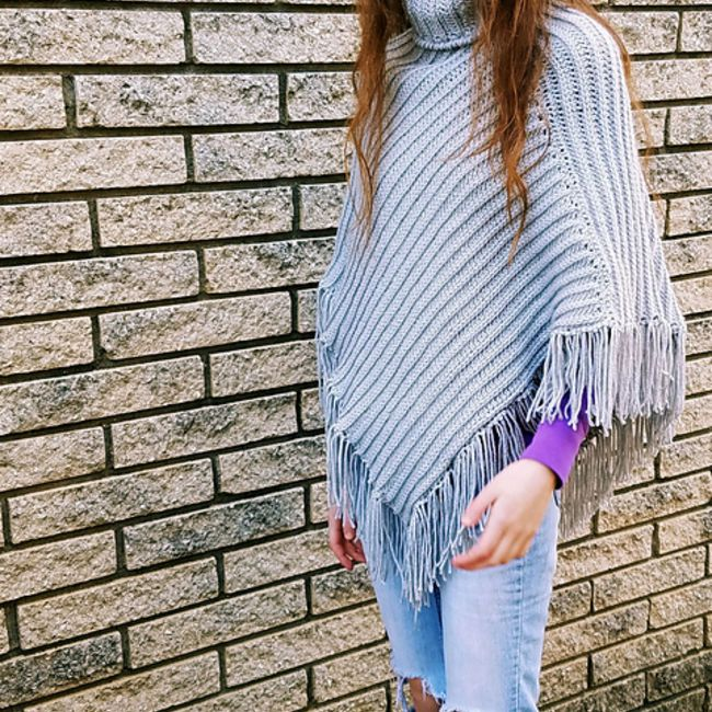 Grey poncho with fringe