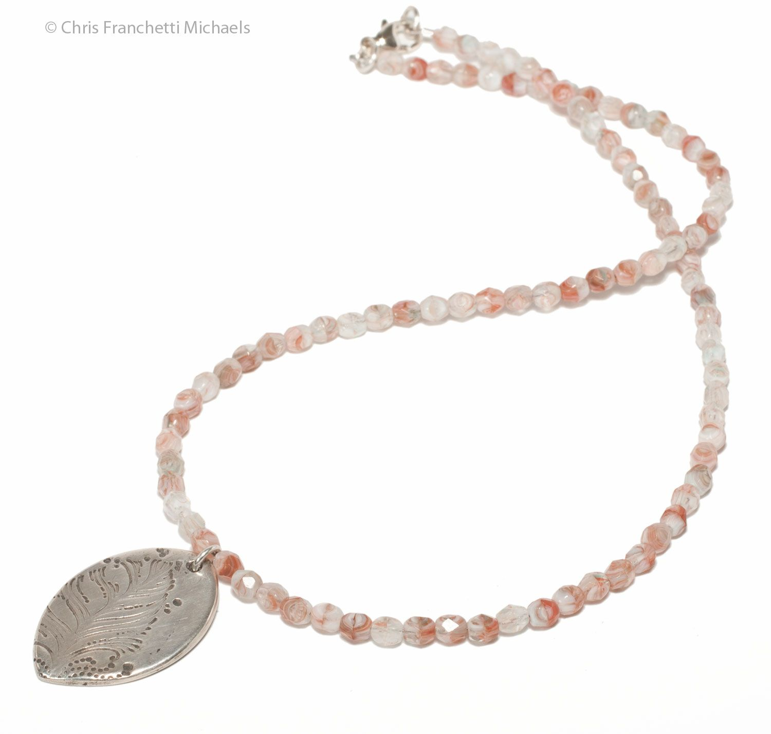 The completed beaded necklace with silver clay pendant.