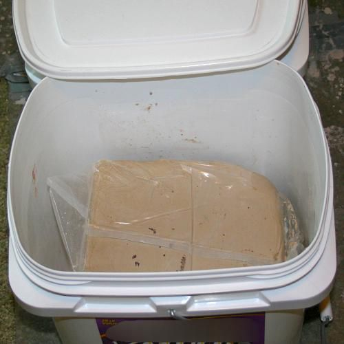 Clay stored in a container.