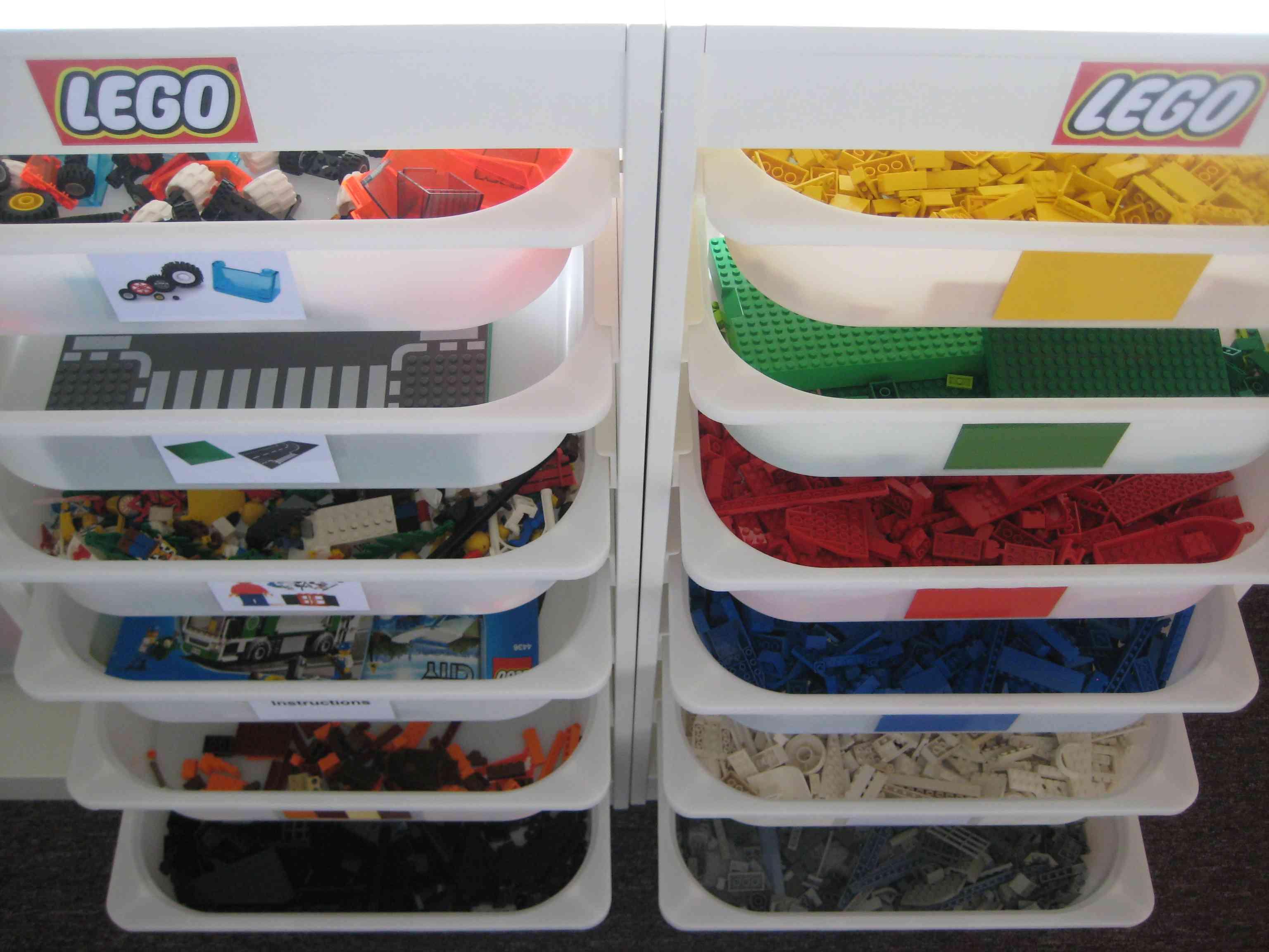 LEGOs in plastic bins organized by color