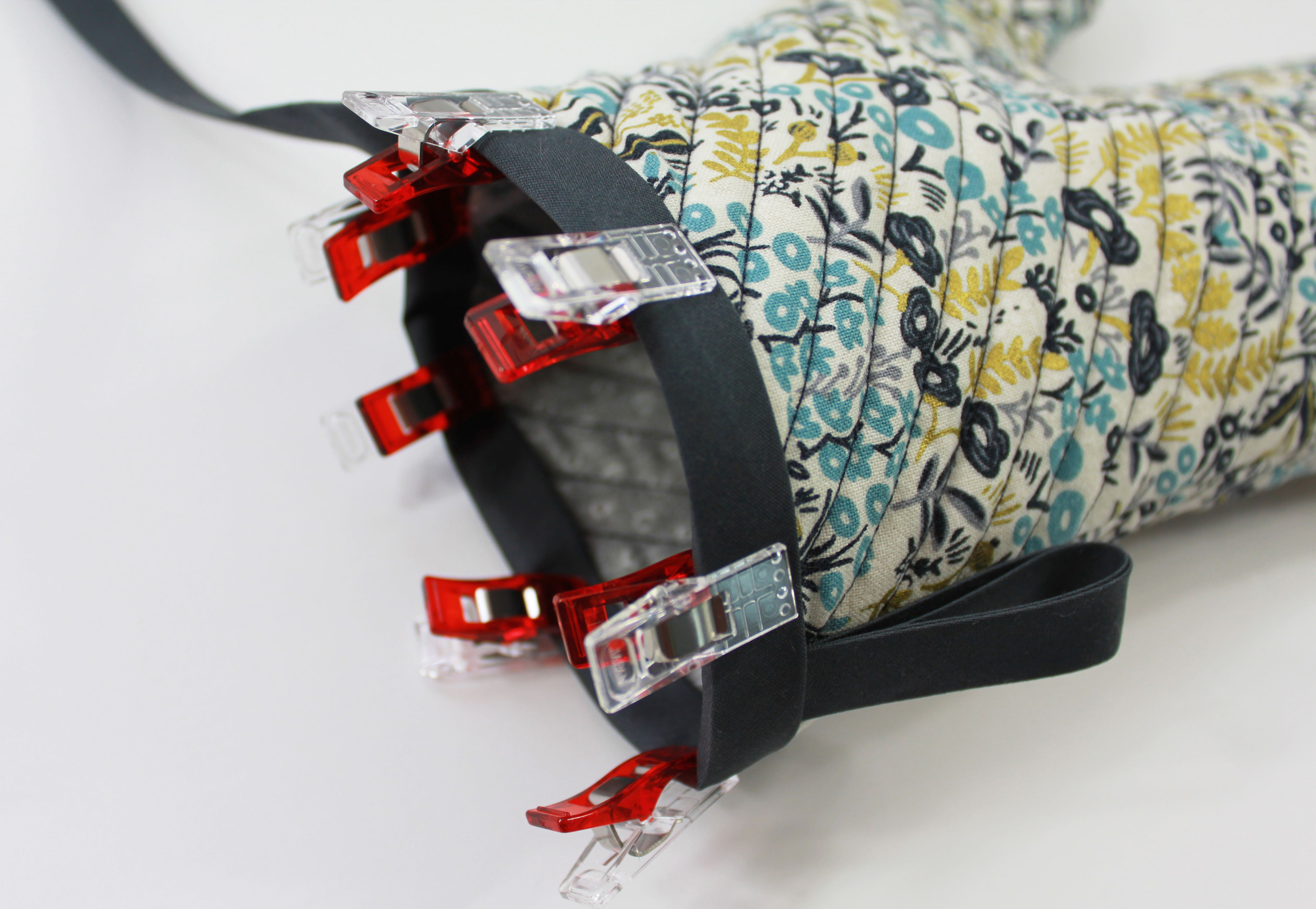 Binding clipped onto an oven mitt