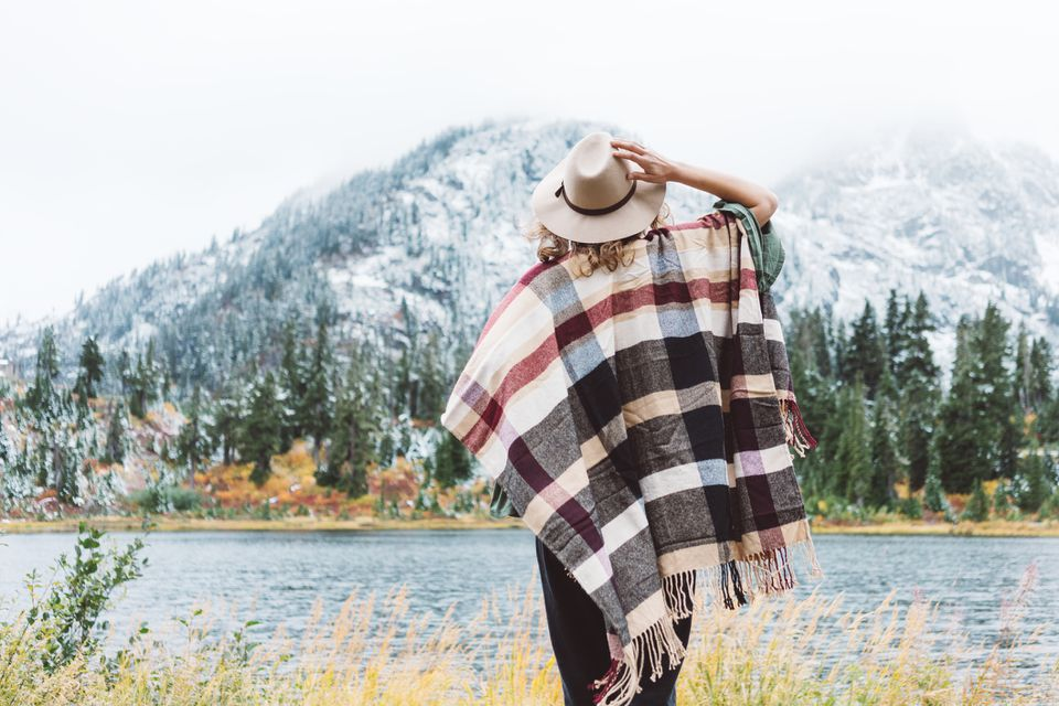Woman traveling among mountains wilderness, boho style