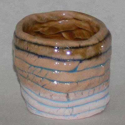 Coil pot with underglazes with dipped clear glaze on exterior and honey-colored glaze on interior.