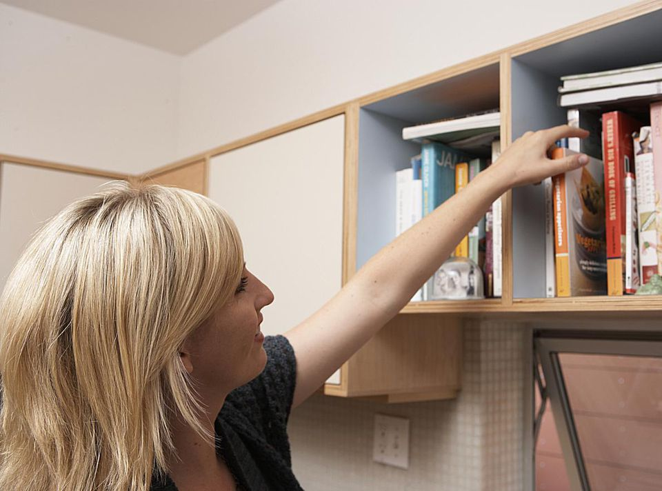 Woman looking at books on shelf