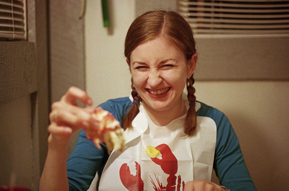 Woman eating lobster