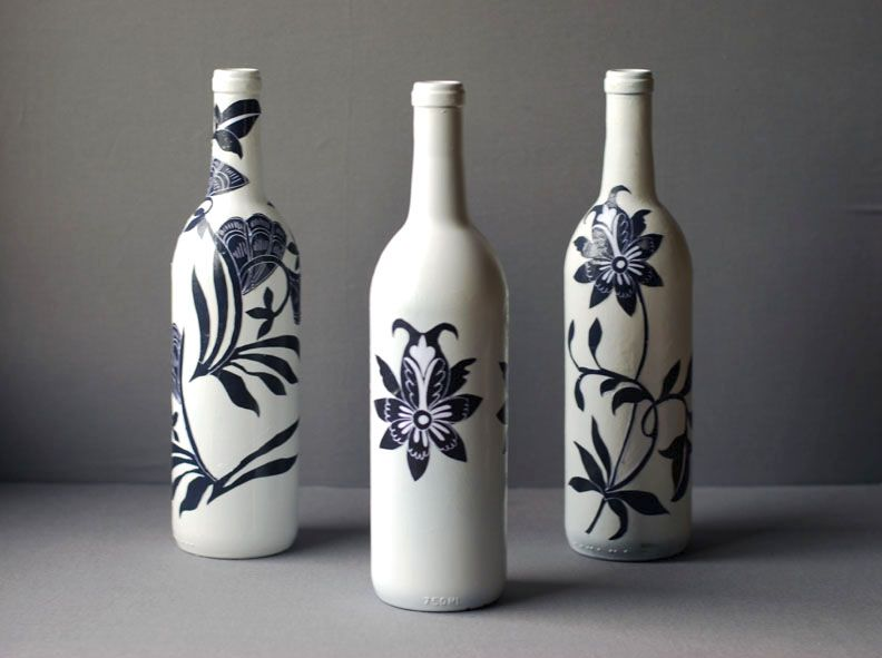 Decoupaged blue and white wine bottles