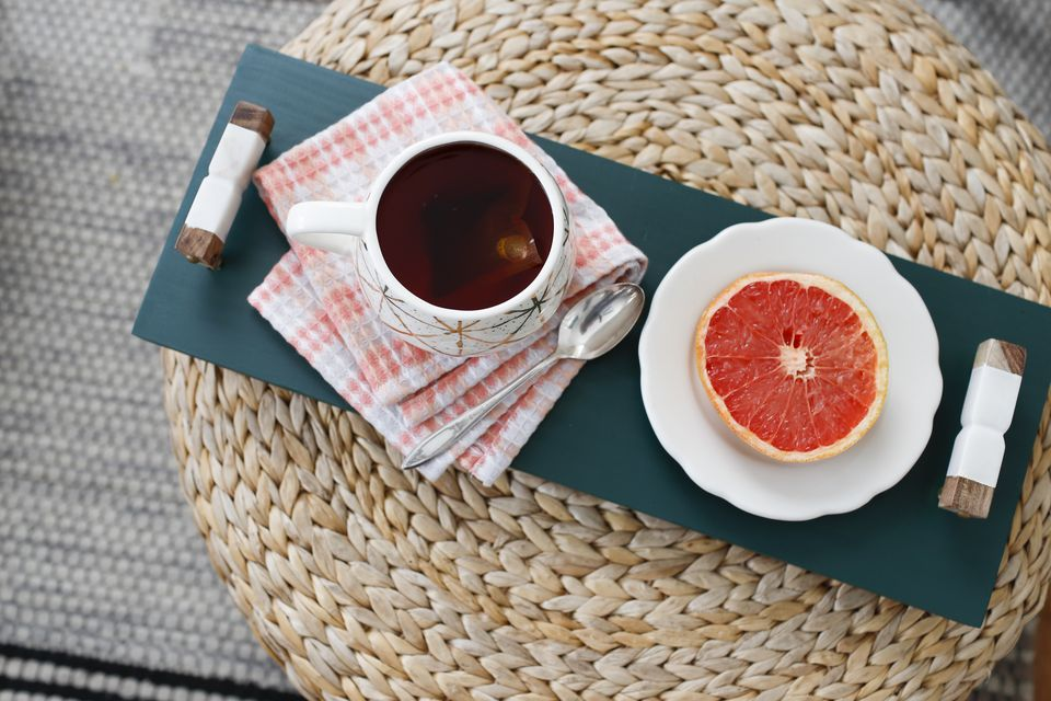 Tea and grapefruit on a serving tray