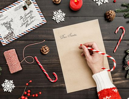 A woman writing to Santa