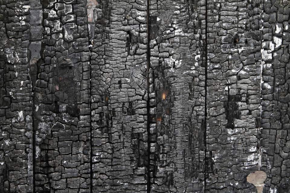 Burned wall of wood plate