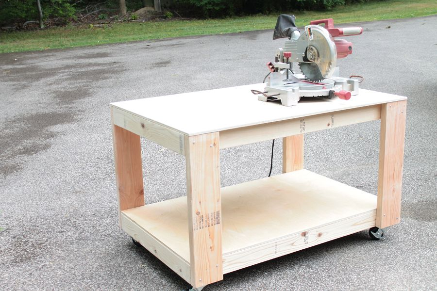A wooden workbench with a saw on top