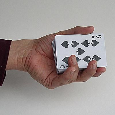 hand holding deck of cards