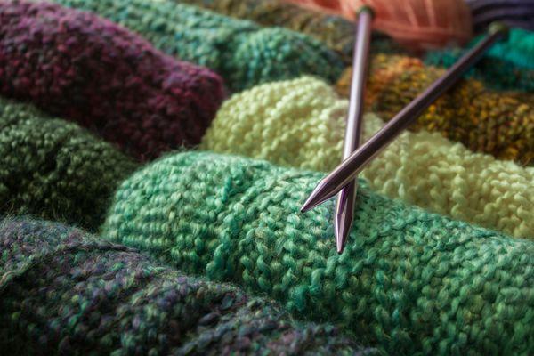 Knitting needles with balls of yarn