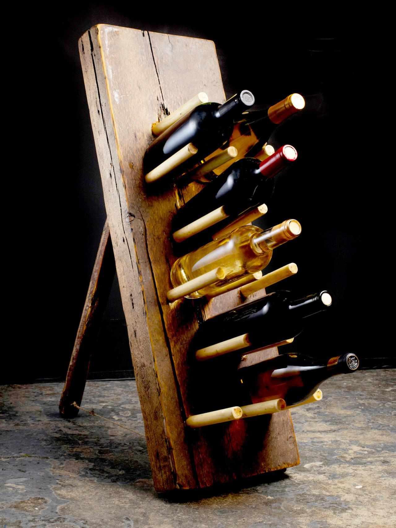 A primitive wine rack that sits upright.