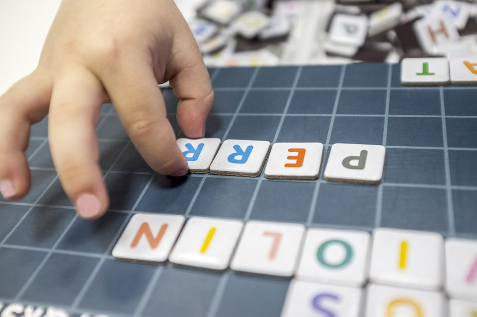 Child practices with word formation board game