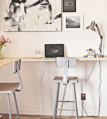 A wraparound standing desk attached to the wall.