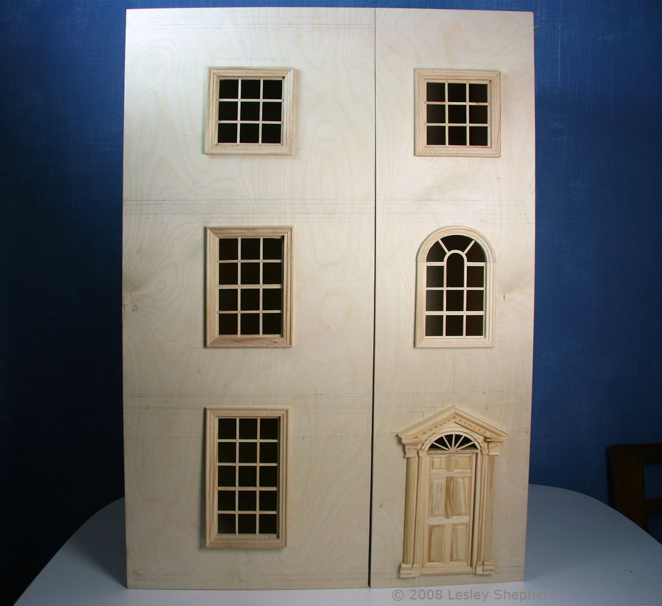 Two asymetric doors on the front of a baby house or bookcase, ready for final finish and trim.