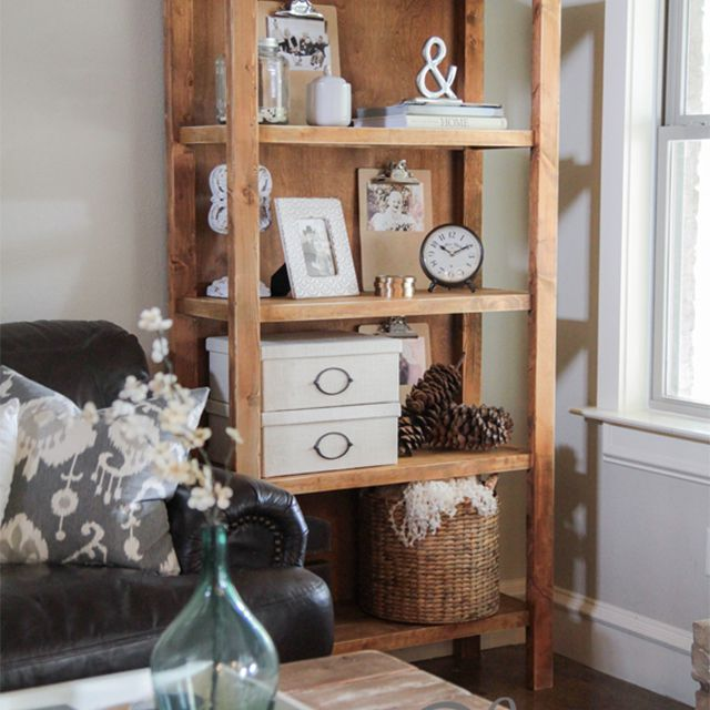 A wooden bookcase in a living room