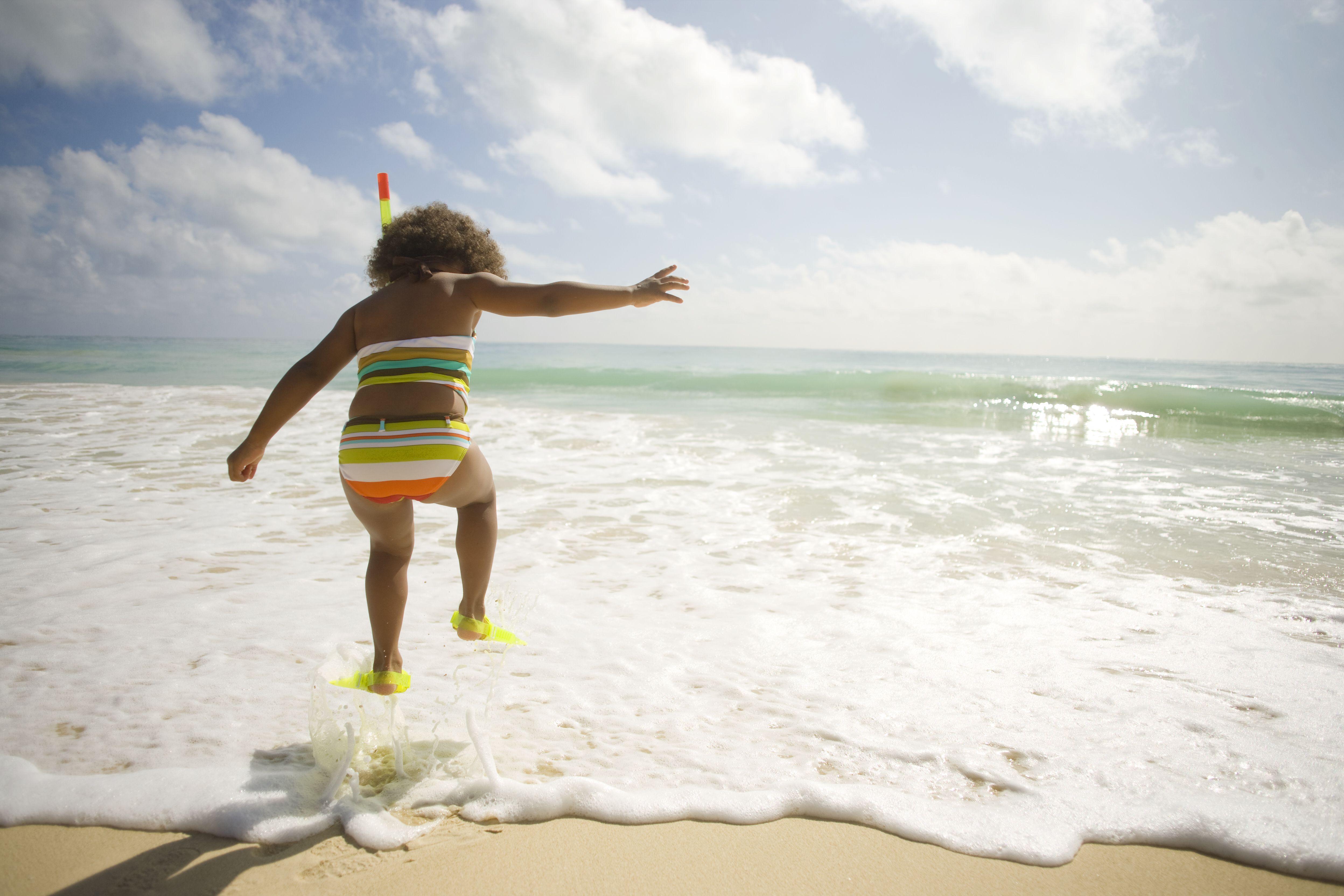little girl with snorkel gear