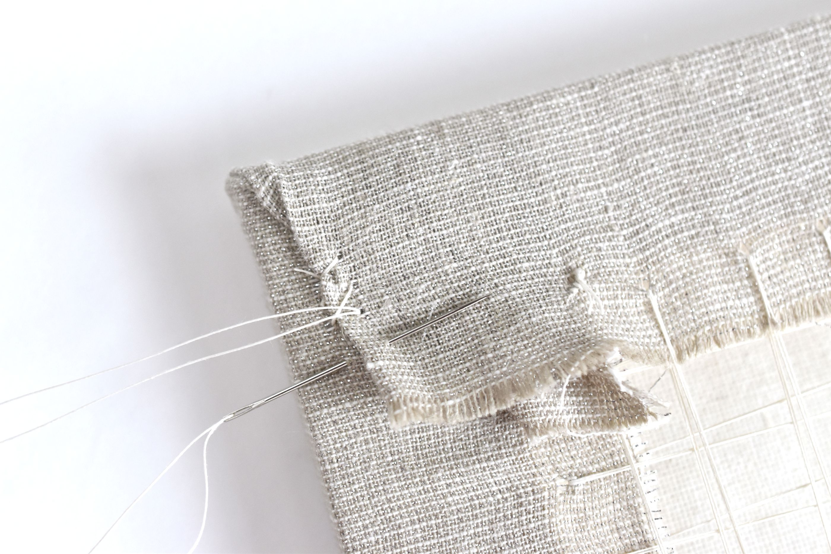 Stitch the Folded Corner to Secure the Fabric