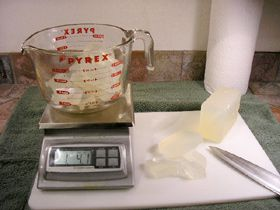 Cutting and weighing the soap Base