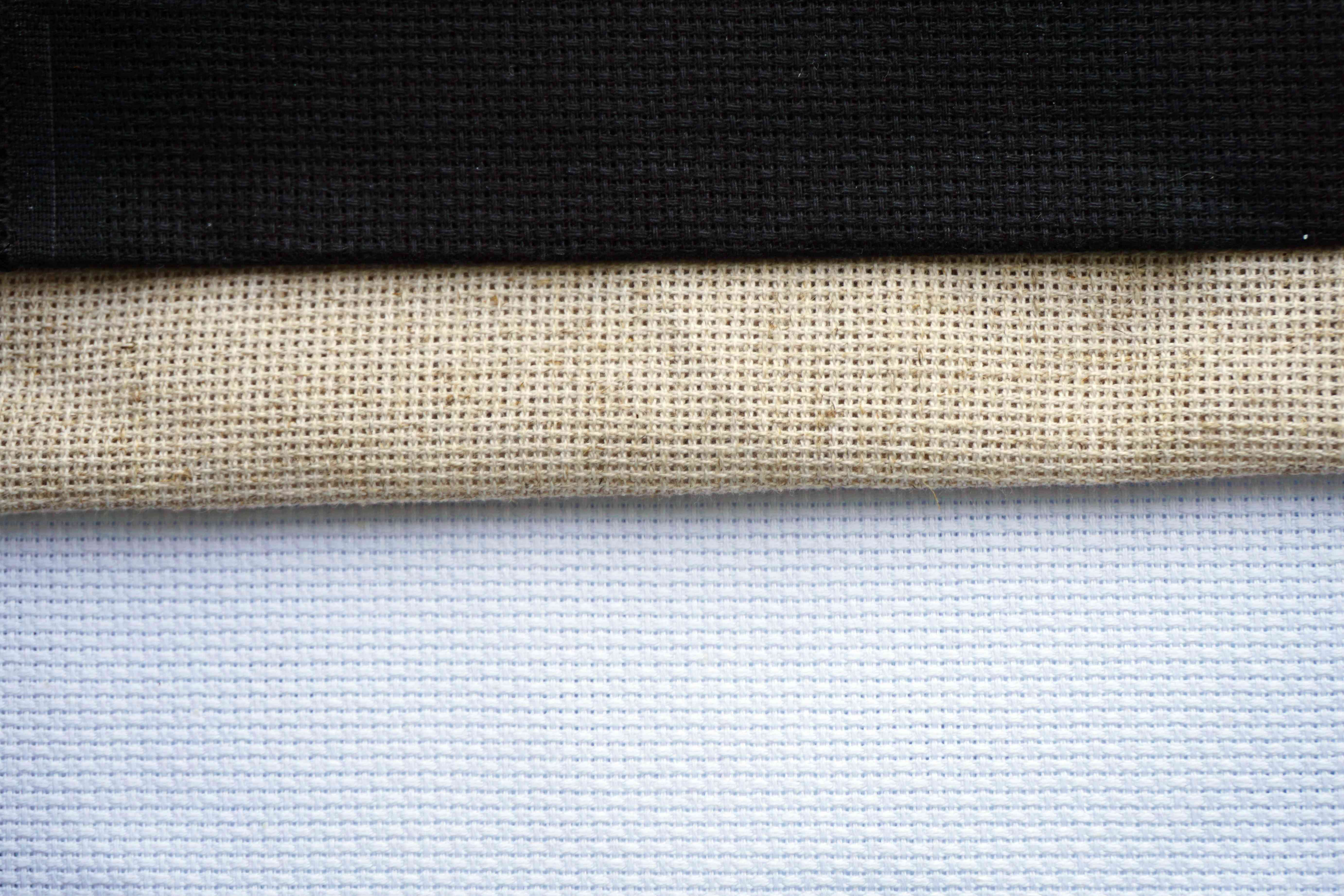 Background for cross stitch with multicolored yarn