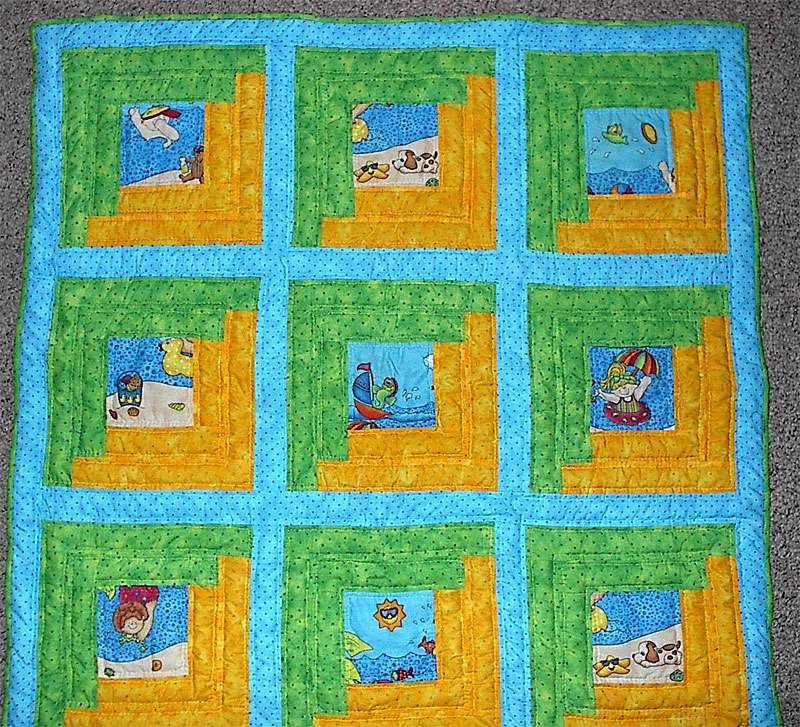 Summer quilt with bright blue colors and beach-themed squares.
