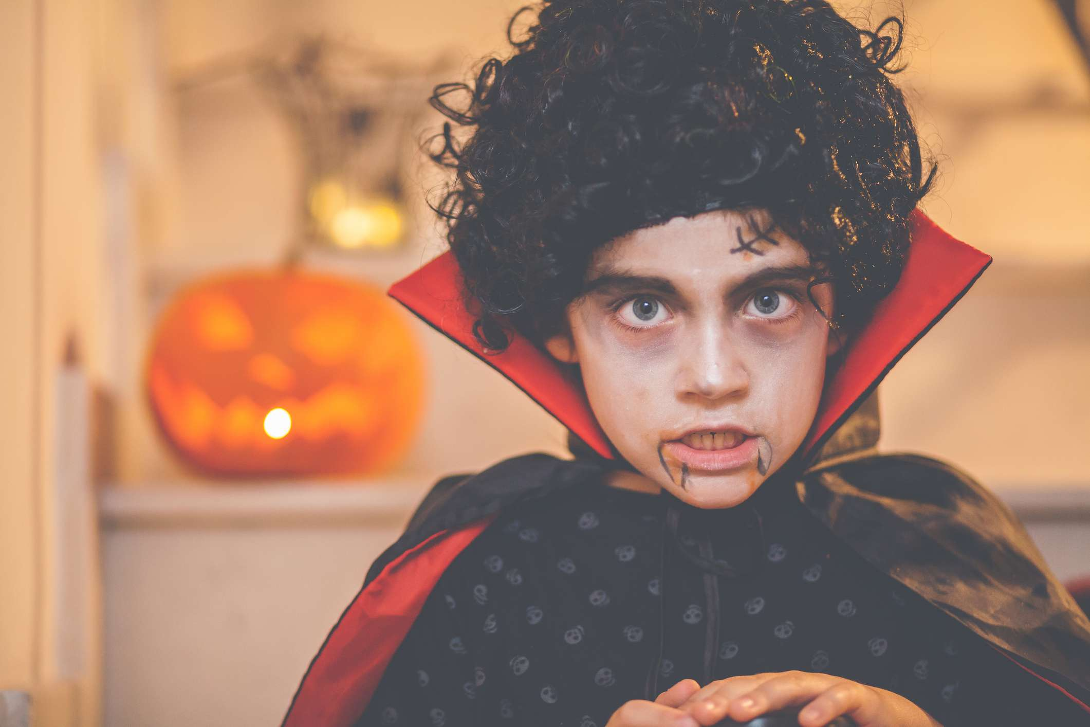 Child wearing dracula vampire costume