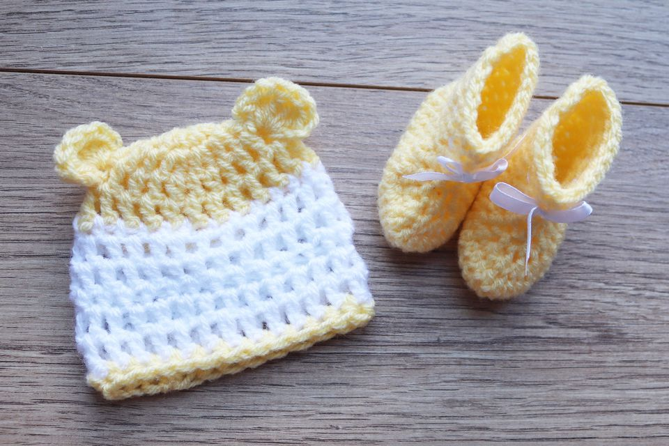 a crochet baby hat and booties