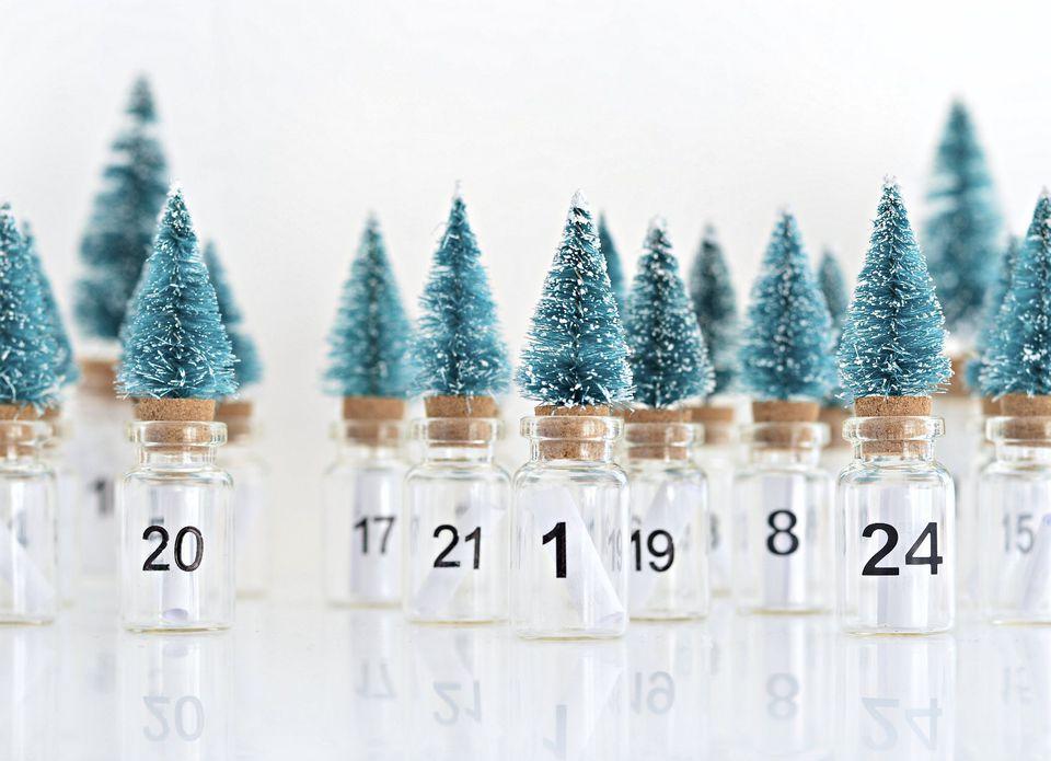 Mini bottle brush trees glued to corked glass bottles.
