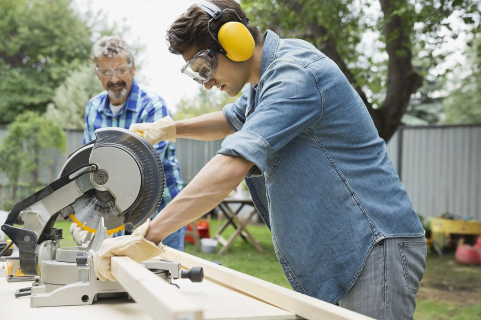 Father and son using a Mitre saw