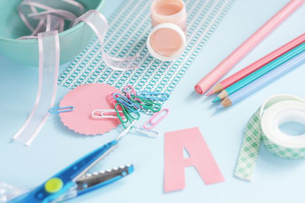 Art craft supplies on blue, green and coral on blue background