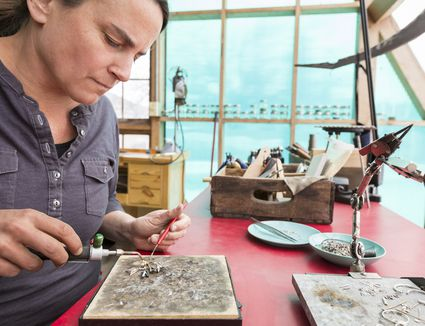 Artisan jewelry maker working in her studio