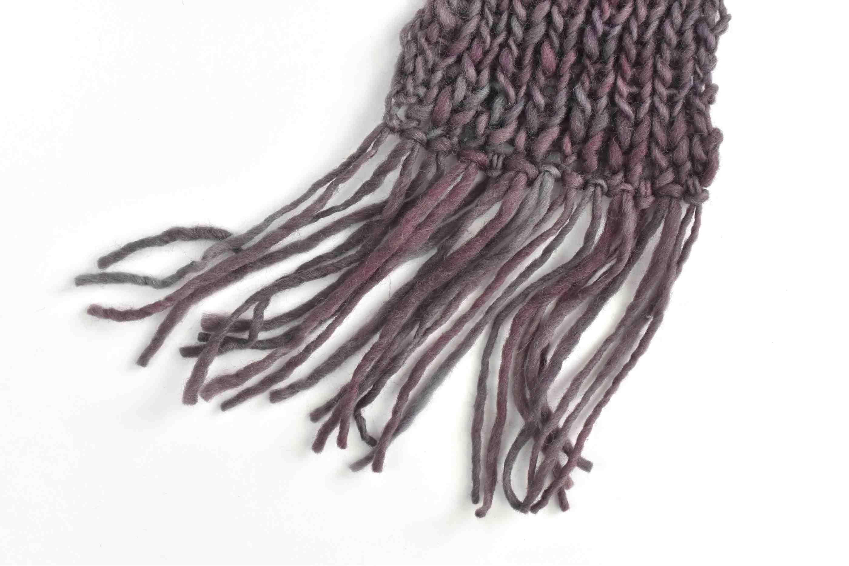 Finished fringe on knitted scarf
